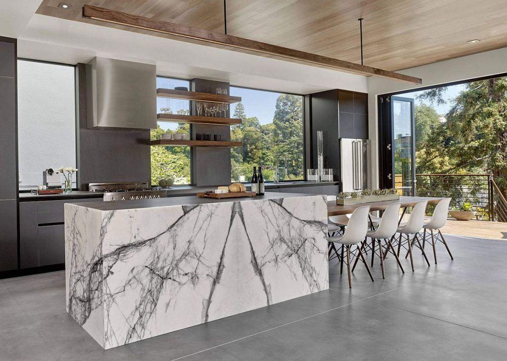 Kaliforniya Evleri   Gray kitchen with a stylish kitchen island that exudes marble sheen 1
